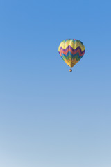 Isolated Hot Air Balloon in a blue sky