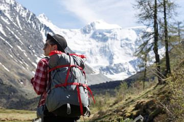 Traveller adventure hiking mountain with backpack and hat. Outdoor retrohipster lifestyle