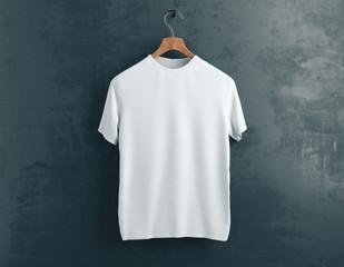 White t-shirt on concrete background