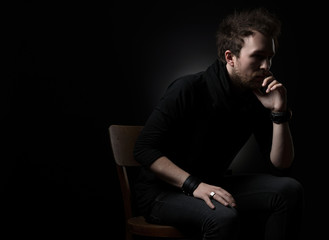 Man thinking on a black background