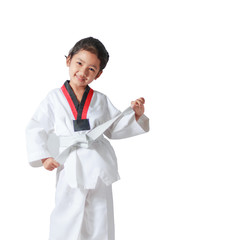 Happy Asian little girl smile and tie a white line in taekwondo uniform isolated on white background