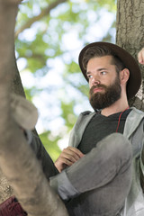 Bearded hipster guy in nature
