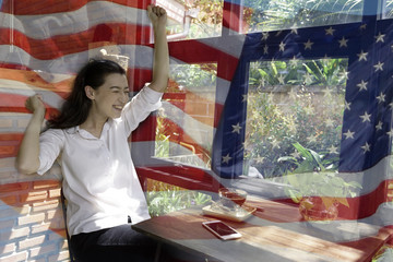 Patriotic composite of happy young half Thai-American woman in happy moment over background of the American flag .4th of july.
