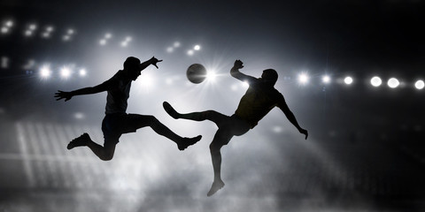 Silhouettes of two soccer players . Mixed media