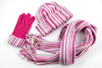 Sweet color pink warm scarf, hat, glove on a white background, set of scarf, hat, glove for winter