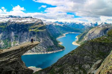 Tuinposter Scandinavië People in nature at Trolltunga (Troll's Tongue) in Norway