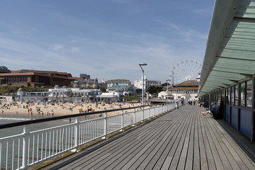 The pier and beach at Bournemouth a popular seaside resort in southern England UK. June 2017