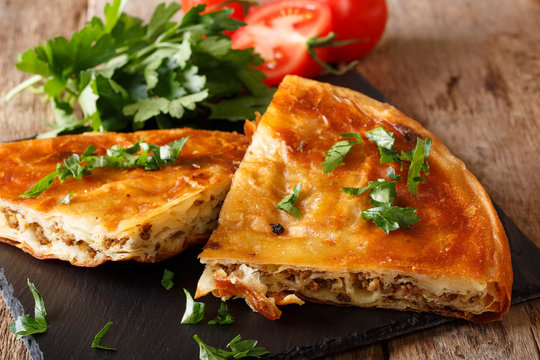 Balkan home burek stuffed with minced meat close-up. horizontal