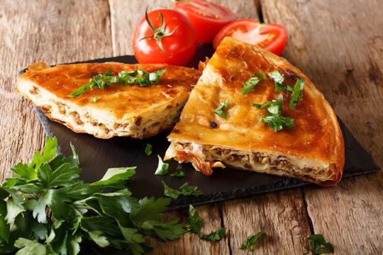 Turkish burek with meat close-up on table. Horizontal
