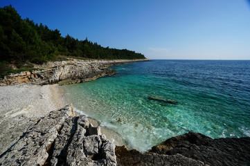 Beach with crystal-clear water in Premantura Pensinsula, Croatia