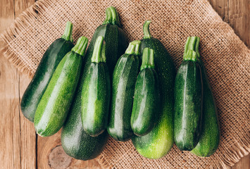 Fresh farmer organic zucchini on a wooden background