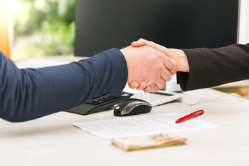 Handshake of business partners after agreement. successful loan contract