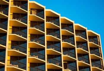 pattern-row of hotel balconies at sunset