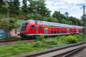 Red European Train Public Transport Motion Blur through Outdoors Area Traveling