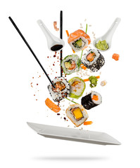 Printed roller blinds Sushi bar Sushi pieces placed between chopsticks on white background