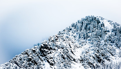 A foggy mountain peak.