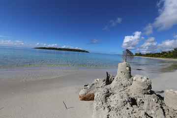 Caribbean beach with melted sand castle