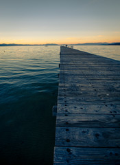 Wooden dock on Lake Tahoe at sunset