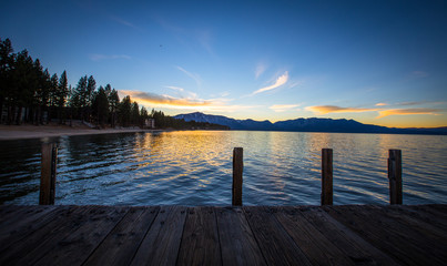 Sunset over Lake Tahoe water and boat dock