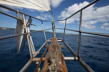 Forward pulpit of a 1941 cutter rigged yawl sailboat in the Caribbean