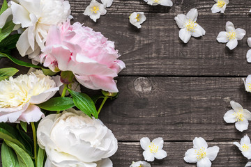 Wedding invitation or anniversary greeting card mockup decorated with pink and creamy peonies and jasmine flowers