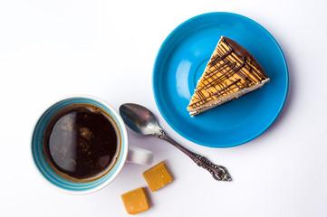 Caramel chocolate cake and a coffee