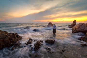Photographer take photo beautiful seascape at sunset in Thailand
