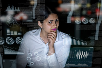 woman looking at futuristic interface screen.