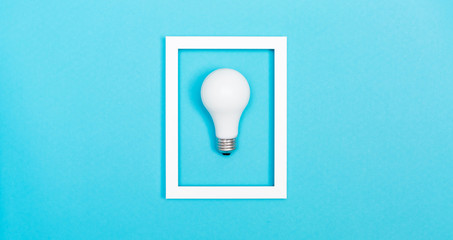Wall Mural - Colored light bulb on vivid colored background