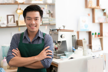 Asian barista is making coffee at his restaurant. And own a coffee shop