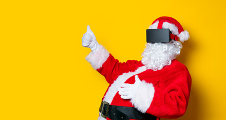Funny Santa Claus have a joy with VR glasses