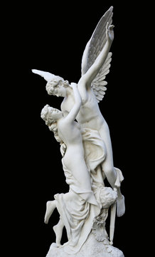 Sculpture of an angel and woman isolated on black background.