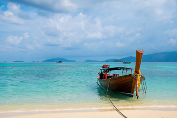 Long tail wooden boat on the blue sea with sky,traditional sea .Thailand
