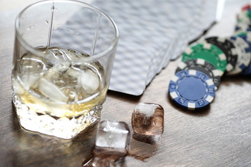 A glass of whiskey and ice on the table