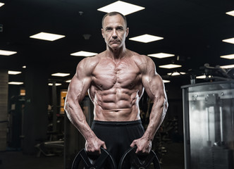 Brutal bodybuilder athletic man with six pack, perfect abs, shoulders, biceps, triceps and chest  Brutal bodybuilder athletic man with six pack, perfect abs, shoulders, biceps, triceps and chest