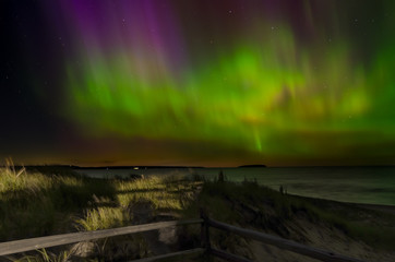 Northern lights on lake superior over autrain beach in northern michigan