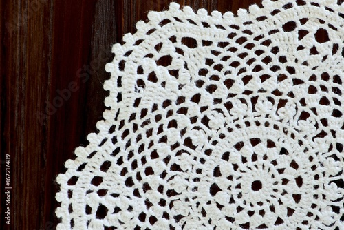 Fragment Of A Vintage Crochet Doily On A Wooden Background Copy