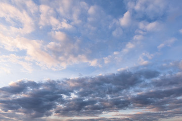 Dark, white and pink clouds against the blue sky, Background