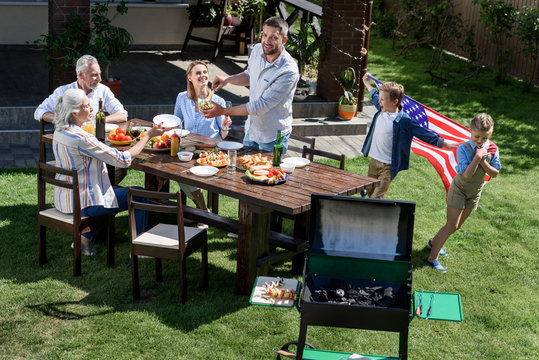 family having barbecue while celebrating 4th july together, Independence Day concept