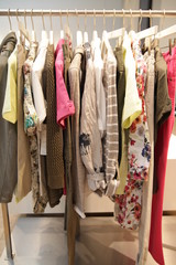 colorful blouses hanging on a clothes rod