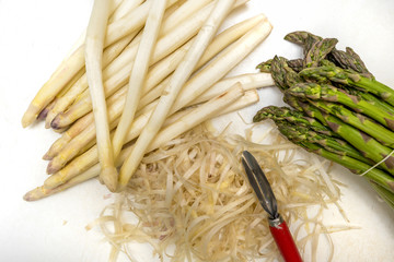 Green and peeled white Asparagus (Asparagus officinalis) in the kitchen