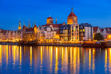 Architecture of the old town in Gdansk over Motlawa river at dusk, Poland