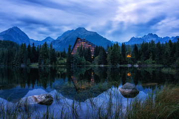 Popular tourist destination in High Tatra mountains, lake Strbske pleso, amazing night landscape with mountains, lake and reflection in the water