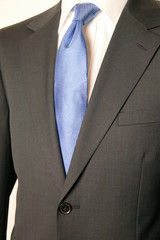 close up of man in a suit with tie and handkerchief