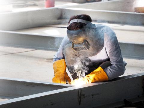 Welding work ,worker with protective welding metal on construction