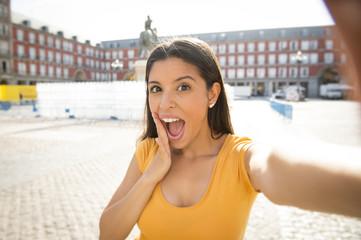 attractive latin woman talking selfie