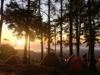outdoor camping vacation with sunrise landscape,camping over mountain for people love adventure lifestyle