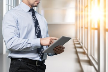 Businessman and digital tablet.