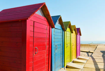 beach huts of different colors