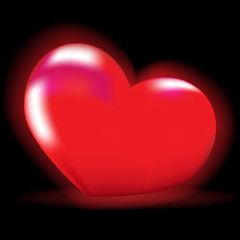 Luminous red heart on a black background